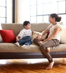 Two children sitting on display WLH Green Futon